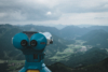 binoculars and mountain valleys